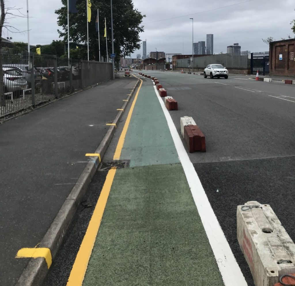 New pop-up cycle lane/expanded pavement on Liverpool Street in Salford