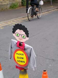 A Walk Ride Whalley Range 'cone child' saying Please Slow Down