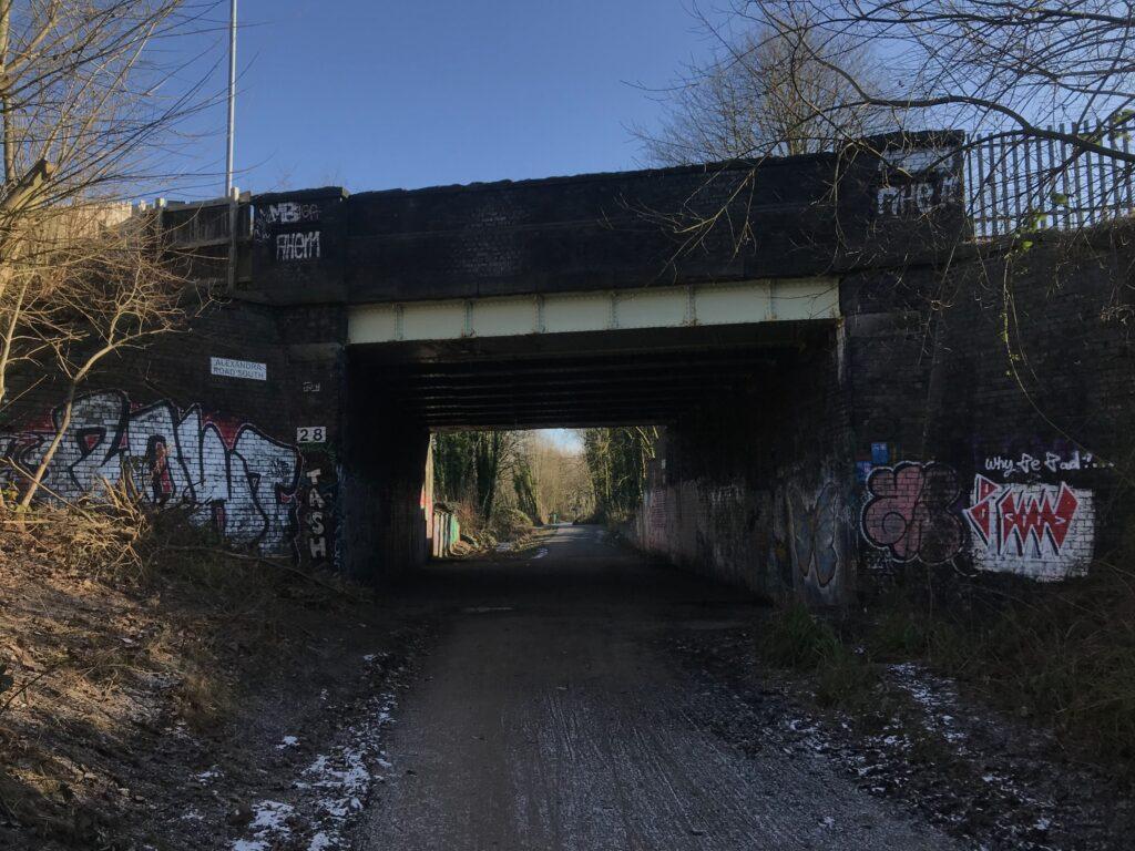 Road bridge crosses Fallowfield loop